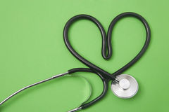 Stethoscope in the shape of a heart Royalty Free Stock Photography