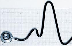 Stethoscope in shape of heart beat on electrocardiogram. Tinted in blue. Stethoscope in the shape of heart beat on electrocardiogram. Tinted in blue stock photo