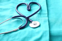 A stethoscope shaping a heart and a clipboard on a Royalty Free Stock Photo