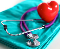 A stethoscope shaping a heart and a clipboard on a Royalty Free Stock Photography