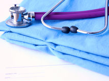 A stethoscope shaping a heart and a clipboard on a Stock Photo