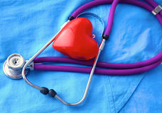 A stethoscope shaping a heart and a clipboard on a Royalty Free Stock Images