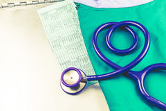 A stethoscope shaping a heart ,medical history folder clipboard Royalty Free Stock Photo
