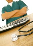 Stethoscope Sitting On Computer Desk Stock Photography