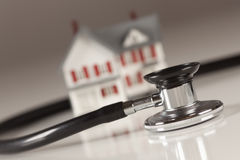 Stethoscope with Small Model Home Stock Photography