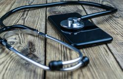 Stethoscope on the smartphone. Smartphone repair and service concept. Concept a health of device stock photos