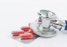 Stethoscope and some pills Stock Photo
