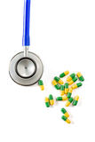 Stethoscope and some pills. On a white background Stock Images