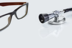 Stethoscope,spectacle on white -Isolated.Concesept of Health and Stock Photography