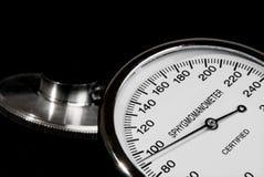 Stethoscope and sphygmomanometer. On black background royalty free stock photos