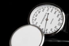 Stethoscope and sphygmomanometer. On black background stock photography