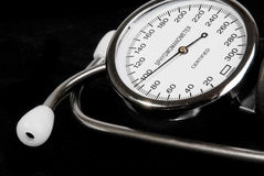 Stethoscope and sphygmomanometer on black Stock Image