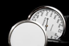 Stethoscope and sphygmomanometer on black background. (close up view royalty free stock images