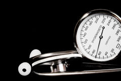 Stethoscope and sphygmomanometer on black background. (close up view stock photography