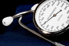 Stethoscope and sphygmomanometer on black background. (close up view royalty free stock image