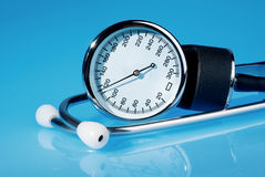 Stethoscope and sphygmomanometer on blue Stock Images