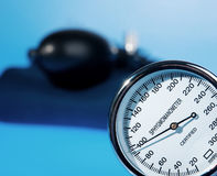 Stethoscope and sphygmomanometer on blue. Background royalty free stock photos