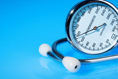 Stethoscope and sphygmomanometer on blue. Background stock photo