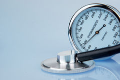 Stethoscope and sphygmomanometer on blue background. (close up view royalty free stock photos