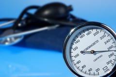 Stethoscope and sphygmomanometer on blue background Stock Image