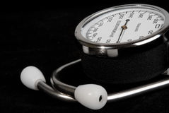 Stethoscope and sphygmomanometer isolated on black. Background royalty free stock photography