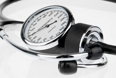 Stethoscope and sphygmomanometer on white Stock Photo