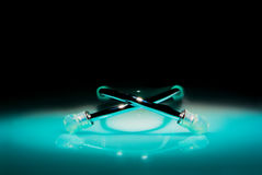 Stethoscope in a spotlight on black background Stock Photos