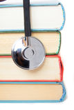 Stethoscope and  stack of books Stock Image