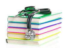 Stethoscope. And stack of books, isolated on white background royalty free stock photos