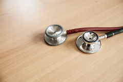 Stethoscope. Still Life-Stethoscope 2 a black and red, placed on a wooden floor. medical equipment Stock Photo