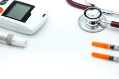 Stethoscope and syringe and glucose meter, lancet using as background health care Medical, Check. Up, Medicine, diabetes, hypoglycemia concept royalty free stock photography