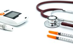 Stethoscope and syringe and glucose meter, lancet using as background health care Medical, Check. Up, Medicine, diabetes, hypoglycemia concept stock images