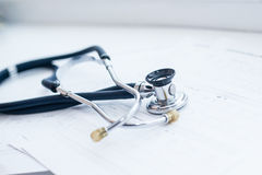 Stethoscope. On table with cardiogram Royalty Free Stock Photography