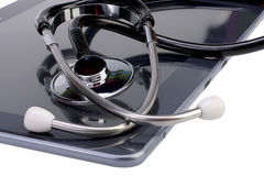 Stethoscope and tablet Stock Images