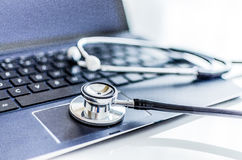 Stethoscope on a tablet Royalty Free Stock Photos