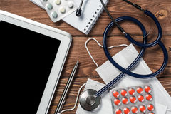 Stethoscope and tablet pc Royalty Free Stock Photos