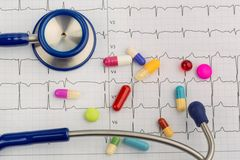 Stethoscope and tablets on an ecg Stock Photo