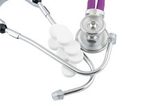 Stethoscope and tablets isolated Stock Photo