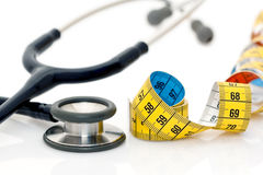 Stethoscope and tape measure Royalty Free Stock Photography