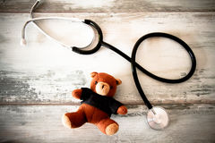 Stethoscope and Teddy bear Stock Photos