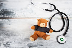 Stethoscope and Teddy bear Royalty Free Stock Images