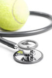 Stethoscope and tennis ball. On isolate background Royalty Free Stock Photos