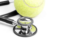 Stethoscope and tennis ball. On isolate background Royalty Free Stock Images