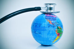 Stethoscope on a terrestrial globe Royalty Free Stock Photo