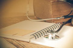 Stethoscope on text book Royalty Free Stock Photo
