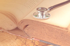 Stethoscope on text book Royalty Free Stock Image