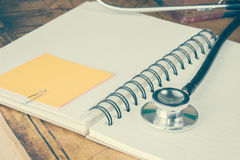 Stethoscope on text book Stock Photo