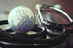 Stethoscope and texture globe with digital tablet Stock Photo