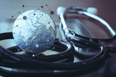 Stethoscope and texture globe with digital tablet Royalty Free Stock Image