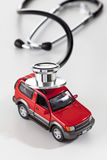 Stethoscope on top of model car Stock Image